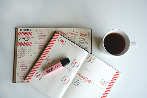 Bullet Journal showing a highlighter, washi tape edges and a cup of coffee